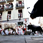 Fiesta De San Fermin Running Of The Bulls - Day 3...PAMPLONA, SPAIN - JULY 08:  Revellers run with Dolores Aguirre's ranch fighting bulls at Curva Estafeta during the third day of the San Fermin Running Of The Bulls festival, on July 8, 2013 in Pamplona, Spain. The annual Fiesta de San Fermin, made famous by the 1926 novel of US writer Ernest Hemmingway 'The Sun Also Rises', involves the running of the bulls through the historic heart of Pamplona for nine days from July 6-14.  (Photo by Pablo Blazquez Dominguez/Getty Images)